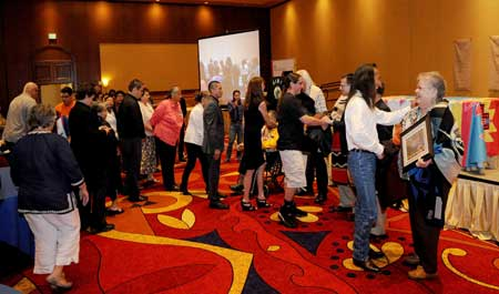 GREETINGS. Conference-goers greet TCU leaders during AIHEC's 40th anniversary celebration at Pojoaque Pueblo's Buffalo Thunder Resort. Photo by Heater Heatley